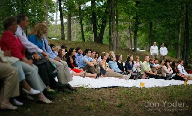 wedding guests on picnic blankets