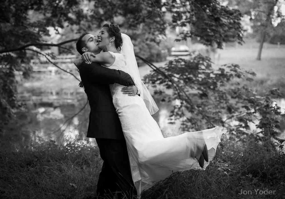 groom carrying kissing bride